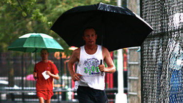 """It's a really good metaphor for life"": Australian Grahak Cunningham running in the rain at the 3100 Mile Race."