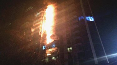 Cladding on the Lacrosse apartments in Docklands burns in the 2014 fire.