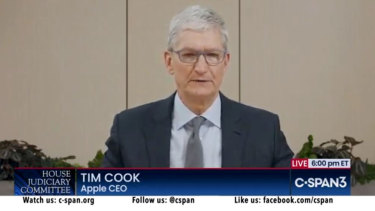 Apple CEO Tim Cook testifying to Congress on online competition.