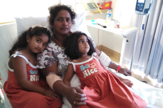 Asylum seeker Priya in hospital on Christmas Island with Kopika, 5, and Tharunicaa, 3, before being taken to Perth.
