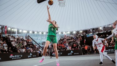 Australia's Carlie Smith lays up against Iran.