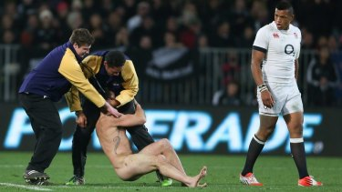 Got him: Brad Hemopo (centre) grabs a streaker during a All Blacks and England match in 2014.