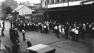 Crowds wait outside McWhirters in Fortitude Valley for free food, date unknown.