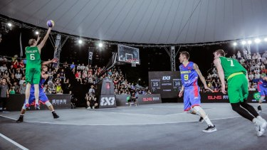 Australia's Tom Garlepp shots the gold-winning shot against Mongolia at the FIBA 3x3 Asia Cup.