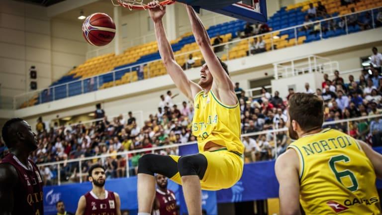 Dominant: Boomers centre Matt Hodgson throws down a dunk against Qatar.