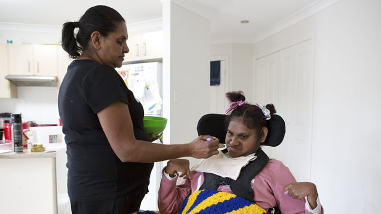 Margaret Vale feeding her daughter Ellen Toby, 20. Ellen needs 24-hour care and is at risk of choking during meals.