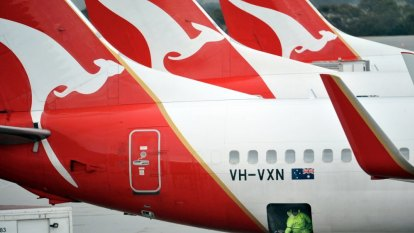 Unions fuming after Qantas stands down workers in 'terrible day'