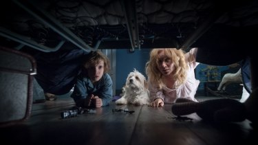 Essie Davis battles with her son's fear of a monster lurking in the house in The Babadook.