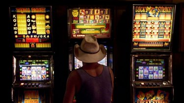 A man plays the pokies at the Goodfellows Hotel Tamworth.