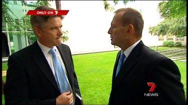 A dramatic pause: Tony Abbott nods at Mark Riley.