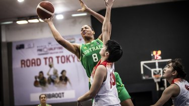 Australia's Liz Cambage shoots over Japan's Ramu Tokashiki in Sunday night's Olympic pre-qualifier.