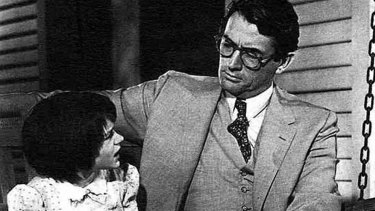 Gregory Peck  as Atticus Finch and and Mary Badham  as his daughter Scout in a scene from the 1962 Hollywood film, To Kill a Mockingbird.