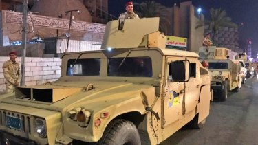 Iraqi security forces stand guard near Bahraini embassy in Baghdad, Iraq.