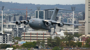 The C-17A Globemaster flys over Woolloongabba on Thursday afternoon in preparation for Riverfire.