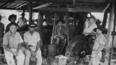 Hans Pearson (far right) in 1965 with fellow workers at the Hope Vale saw mill in far north Queensland.