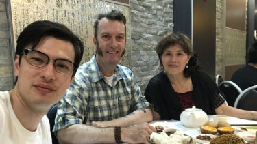 Alek Sigley with his parents in a photo from his blog.