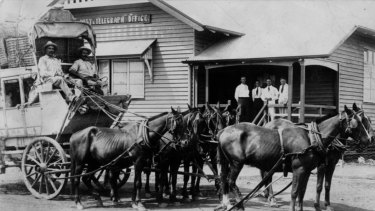 The photograph was originally titled 'Cobb & Co. coach in front of a unknown post office, ca. 1920' until a viewer helped determine the unnamed post office could be the Cloncurry Post and Telegraph Office.
