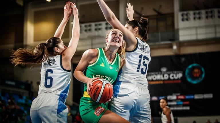 Splitting the gap: Opals forward Alanna Smith drives to the basket against Argentina.