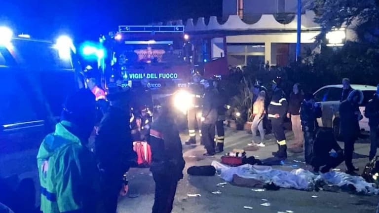 Rescuers assist injured people outside a nightclub in Corinaldo, central Italy.
