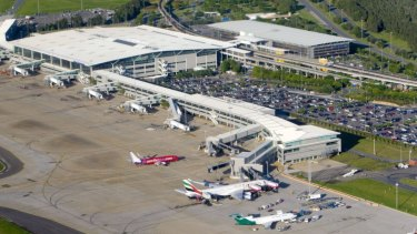 NSW police officers arrested the man at Brisbane International Airport early on Tuesday morning.