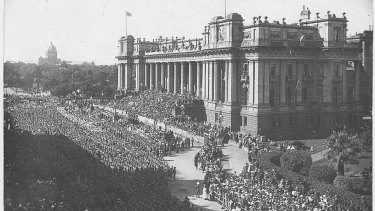 Crowds gather in front of Parliament House for armistice celebrations, 1918.