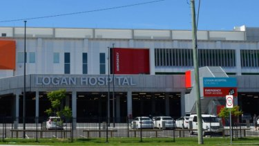 Staff were left shaken after a student nurse was allegedly car-jacked at gunpoint out the front of the hospital.