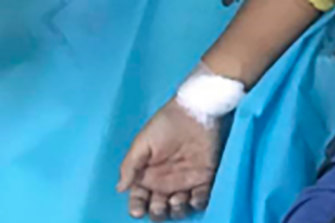 Seven-year-old Ma Khin Myo Chit, whose hand is pictured above, was killed at her home in Mandalay, Myanmar.
