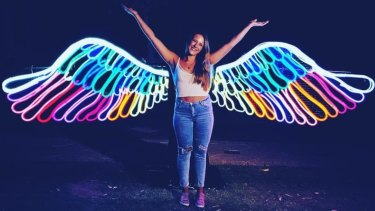 Pose with Neon Angel Wings at this year's Enlighten.