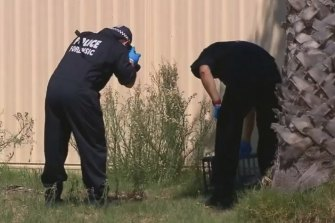 Forensic police outside the home of Nick Martin's accused killer for a second time this week after an intruder scaled the fence.