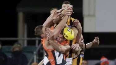 A throng of players contest the mark during the Hawks win over GWS.