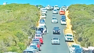 Cars line the street in Point Addis on the Great Ocean road on Saturday.