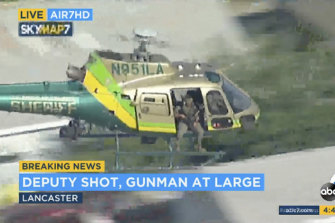 A sheriff's department helicopter with a sniper in an open door search for what they thought was a gunman at large in Lancaster, California.