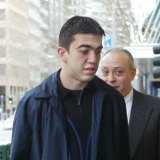 Faruk Orman (centre) outside Melbourne Magistrates Court in 2004.