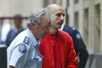 Hoddle Street mass murderer Julian Knight enters court in 2003.