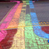 The Court Hotel chalked its sidewalks for Rainbow Riots.