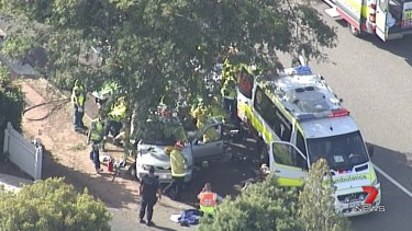 The crash scene in Murrumba Downs after a car lost control on a roundabout and hit a tree.