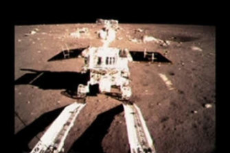 China's first moon rover, Yutu, or Jade Rabbit, moves onto the lunar surface.