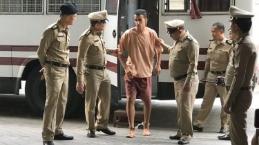 Hakeem Al-Araibi arrives at the Bangkok court on Monday with his legs shackled.