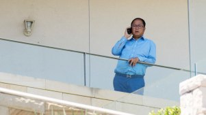 Chinese political donor Huang Xiangmo pictured on the balcony of his Mosman mansion last year.
