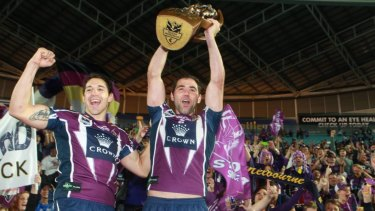 Cameron Smith and Billy Slater celebrate with their fans after winning the 2012 NRL Grand Final.
