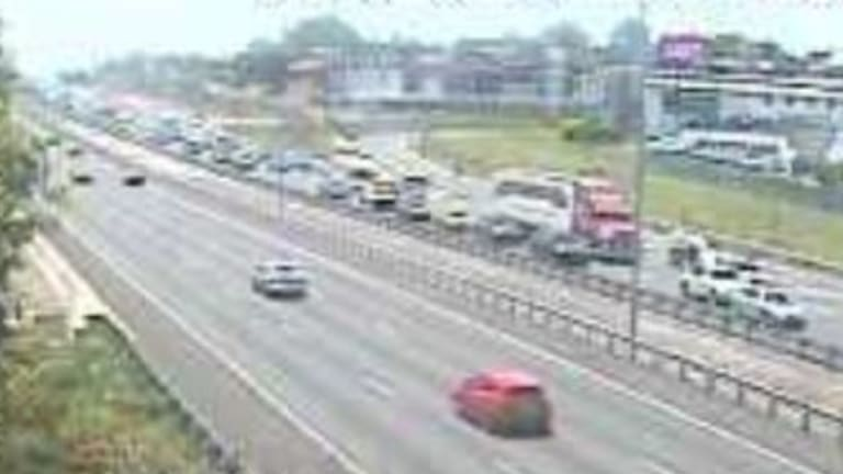 A north-facing traffic camera captured the chaos on the M1 through Slacks Creek just before 1pm on Saturday.