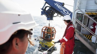 Scientists launch the ROV from the Stril Explorer.