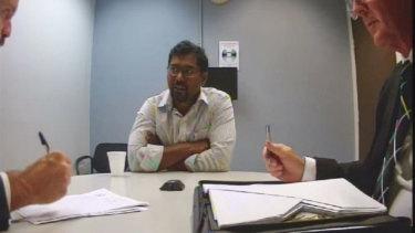 Dinakar Tayi speaks to police in December 2018.