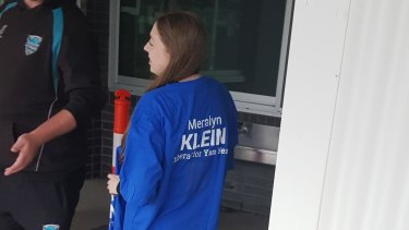 A volunteer a Liberal Party shirt bearing Meralyn Klein's name. The word 'Liberal' was later covered with masking tape.