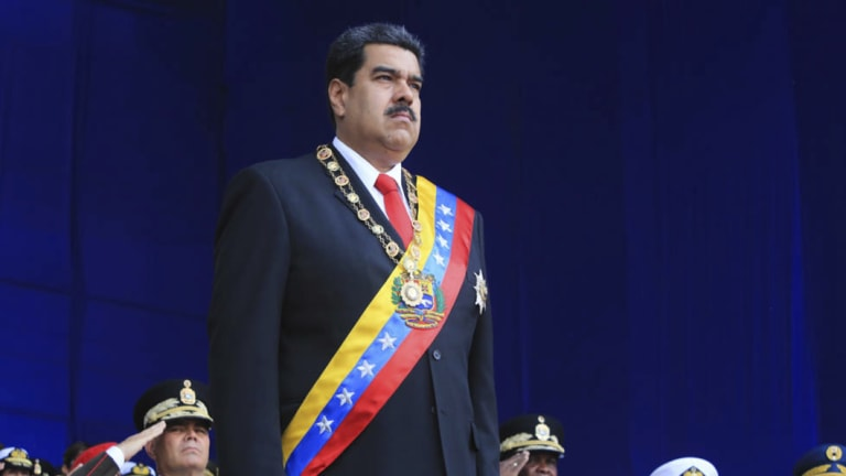 President Nicolas Maduro stands at attention during a event marking the 81st anniversary of the National Guard, in Caracas, Venezuela, on Saturday before the explosions.