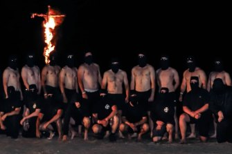 National Socialist Network members set fire to a cross during a visit to the Grampians National Park at the weekend.