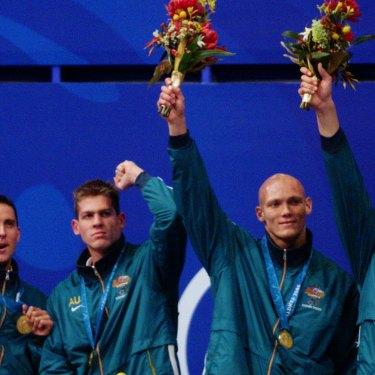 Bill Kirby, Todd Pearson, Michael Klim and Ian Thorpe celebrate another gold medal and another world record in the Sydney pool.