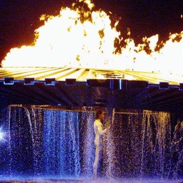 The cauldron rises above Cathy Freeman on September 15, 2000.