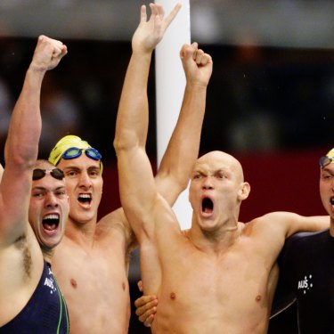 Ashley Callus, Chris Fydler, Michael Klim and Ian Thorpe celebrate their gold in the 4x100m relay. The Australians set a world record of 3:13.67 while Klim also broke the individual world record, finishing his leg in 48.18s.