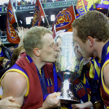 Michael Voss and Justin Leppitsch celebrate winning the 2002 AFL premiership.
